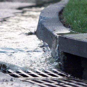 water running in to storm drain catch basin