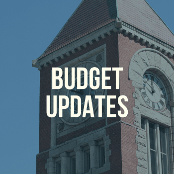 "Amherst Town Hall Clock Tower with text stating ""budget updates"""