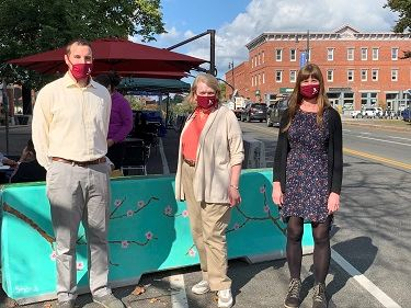 Amherst Town Planners stand in Downtown Amherst with masks on