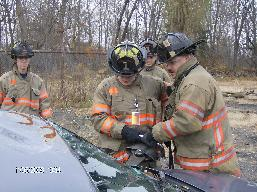 Firefighters practice vehicle extrication.